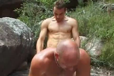 two males fuck In Forest